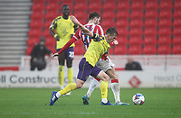 Huddersfield Town's Jonathan Hogg in action with  Stoke City's Nick Powell<br /> <br /> Photographer Mick Walker/CameraSport<br /> <br /> The EFL Sky Bet Championship - Stoke City v HUddersfield Town - Saturday 21st November 2020 - bet365 Stadium - Stoke<br /> <br /> World Copyright © 2020 CameraSport. All rights reserved. 43 Linden Ave. Countesthorpe. Leicester. England. LE8 5PG - Tel: +44 (0) 116 277 4147 - admin@camerasport.com - www.camerasport.com