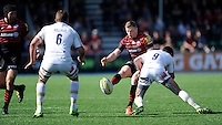 Chris Ashton of Saracens chips past Jonny Arr (r) and Mike Williams of Worcester Warriors during the Aviva Premiership match between Saracens and Worcester Warriors at Allianz Park on Saturday 3rd May 2014 (Photo by Rob Munro)
