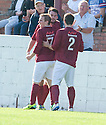 Linlithgows' Tommy Coyne celebrates after he scores their first goal.