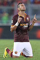 ROME, Italy - September 1, 2013: Roma beats Verona 3-0 during the Serie A match in Olimpico Stadium. In the photo the brazilian defender Leandro Castan prying at the end of the match