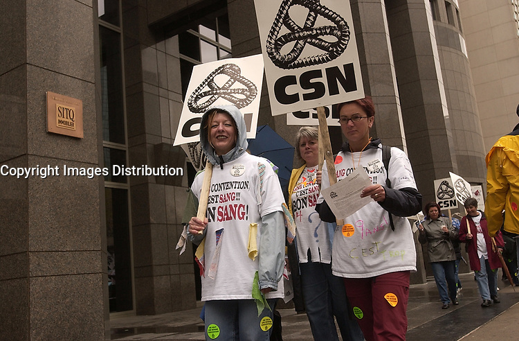 CSN union members demonstrate in downtown Montreal.  Copyright  : 2003 Images Distribution