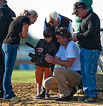 The Bodemeister himself, Bode Baffert, looks at video with videographer John Hennegan as his parents Jill and Bob join in on Black-Eyed Susan Day at Pimlico Race Course in Baltimore, Maryland on May 18, 2012.