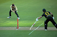 NZ's Mitch Santner fields during the 4th international men's T20 cricket match between the New Zealand Black Caps and Australia at Sky Stadium in Wellington, New Zealand on Friday, 5 March 2021. Photo: Dave Lintott / lintottphoto.co.nz