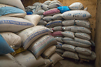 Family Bags of Millet in Storehouse, Bijam, a Wolof Village, near Kaolack, Senegal.  Many family names are written in the Arabic alphabet. DOZENS MORE OF IMAGES RELATED TO MILLET CULTIVATION ARE AVAILABLE.  WHAT DO YOU NEED?
