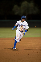 AZL Dodgers second baseman Kenneth Betancourt (3) hustles towards third base during an Arizona League game against the AZL White Sox at Camelback Ranch on July 3, 2018 in Glendale, Arizona. The AZL Dodgers defeated the AZL White Sox by a score of 10-5. (Zachary Lucy/Four Seam Images)