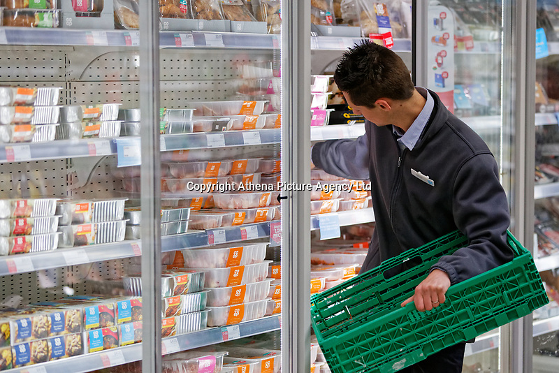 A store assistant stocks shelves