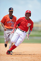 GCL Nationals third baseman Anderson Franco (11) running the bases as Wander Franco (22) looks on during a game against the GCL Astros on August 14, 2016 at the Carl Barger Baseball Complex in Viera, Florida.  GCL Nationals defeated GCL Astros 8-6.  (Mike Janes/Four Seam Images)