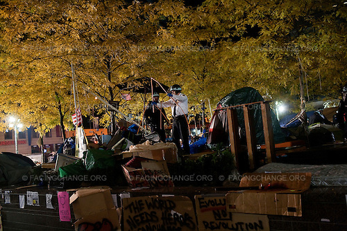 New York, New York.November 15, 2011..The Occupy Wall Street encampment in Lower Manhattan's Zuccotti Park / Liberty Plaza was evicted in the middle of the night by the New York Police Department and the Department Of Sanitation removed tents and personal belongings of the protestors...Over 70 demonstrators were arrested.