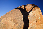 A single ghost gum tree casts its shadow across the Devil's Marbles, Northern Territory, Australia.