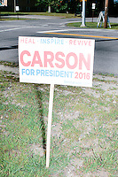 Political signs for Republican presidential candidate Dr. Ben Carson stand near traffic at Londonderry Old Home Day in Londonderry, New Hampshire. Carson later showed up at the event to meet New Hampshire voters.
