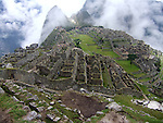 A view of Machu Picchu with fog.