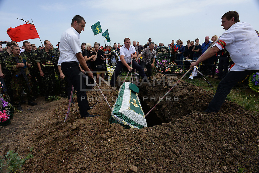 Relatives, friends and soldiers mourn  Pro-Russian activist Alexander Gizay at funerals of eight murdered by Ukraine army airstrike on Lugansk. June 06, 2014