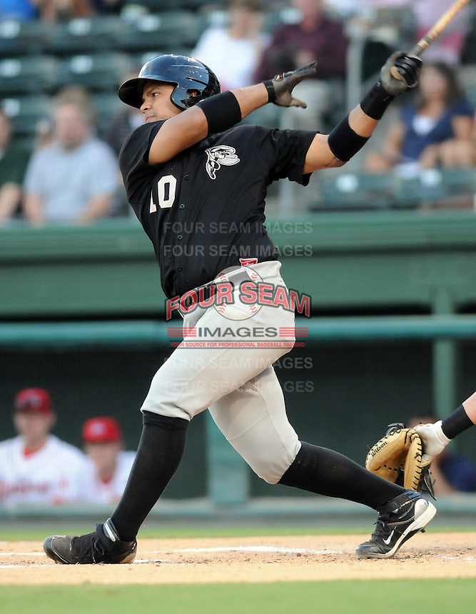 Catcher Juan Torres (10) of the Savannah Sand Gnats in Game 1 of the South Atlantic League Southern Division Championship against the Greenville Drive on Sept. 8, 2010, at Fluor Field at the West End in Greenville, S.C. Photo by: Tom Priddy/Four Seam Images