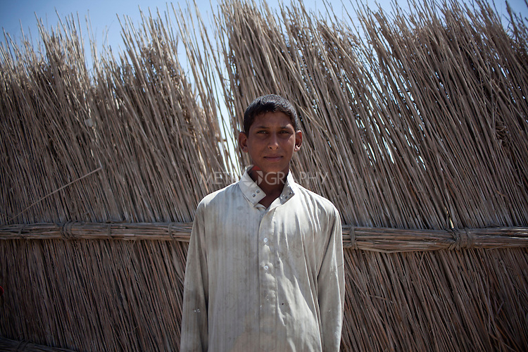 AL-SELKHA, IRAQ: A teenage boy from the village of Al Selkha...Dozens of families displaced by years of violence live in the village of Al Selkha in Nasiriya...Photo by Ali Arkady/Metrography
