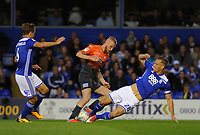 Swansea City's Oli McBurnie (C) is tackled by Birmingham City's Michael Morrison (R) during the Sky Bet Championship match between Birmingham City and Swansea City at St Andrew's Trillion Trophy Stadium on August 17, 2018 in Birmingham, England.