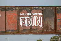 """Will You Marry Me Erin?"" is a marriage proposal graffiti painting on the Austin Railroad Graffiti Bridge over Lady Bird Lake in downtown Austin, Texas."