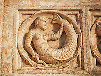 Medieval relief sculptures of mythical mermaid on the exterior of the Romanesque Baptistery of Parma, circa 1196, (Battistero di Parma), Italy