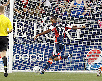 New England Revolution substitute forward Jerry Bengtson (27) scores his first MLS goal. In a Major League Soccer (MLS) match, New England Revolution defeated New York Red Bulls, 2-0, at Gillette Stadium on July 8, 2012.