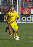 18 May 2013: Columbus Crew forward Justin Meram #9 in action during an MLS game between the Columbus Crew and Toronto FC at BMO Field in Toronto, Ontario Canada..The Columbus Crew won 1-0...