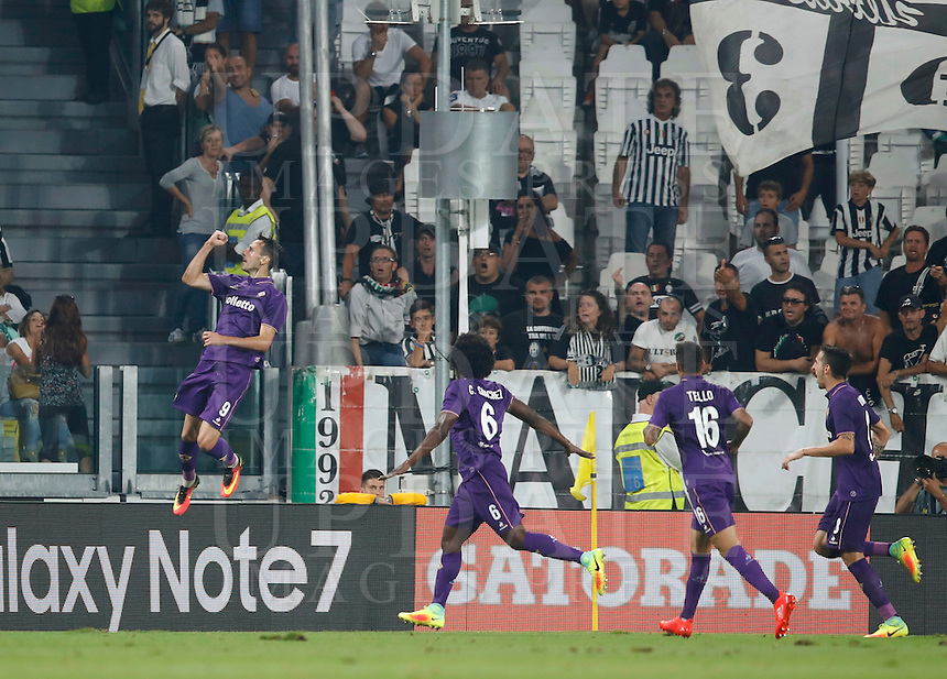 Calcio, Serie A: Juventus vs Fiorentina. Torino, Juventus Stadium, 20 agosto 2016.<br /> Fiorentina's Nikola Kalinic, left, celebrates with teammates, from second from left, Carlos Sanchez, Cristian Tello and Matias Vecino, after scoring during the Italian Serie A football match between Juventus and Fiorentina at Turin's Juventus Stadium, 20 August 2016. Juventus won 2-1.<br /> UPDATE IMAGES PRESS/Isabella Bonotto