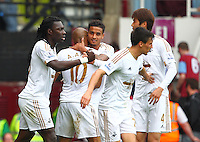 Bafetimbi Gomis of Swansea celebrates scoring his sides fourth goal with team-mates    during the Barclays Premier League match between West Ham United and Swansea City  played at Boleyn Ground , London on 7th May 2016
