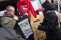"""Am Samstag den 31. Januar 2015 versammelten sich auf dem Staromestske Namesti-Platz (Alststaetter Markt / Old Town Square) in Prag ca. 500 Anhaenger der Pegida-Bewegung. Wie in Deutschland sind die Pegida (Patriotische Europaere gegen die Islamisierung des Abendlandes) Neonazis, Hooligans, Islamsfeinde und sog. """"Besorgte Buerger"""".<br /> Gegen die Pegida-Kundgebung protestierten Vertreter verschiedener Religionen, Antifaschisten, Sinti und Roma mit einem Gottesdienst, Gesaengen und Plakaten und Schildern, auf denen sich zum Teil ueber die Islamophobie der Pegida-Anhaenger lustig gemacht wurde. Beide Veranstaltungen fanden gleichzeitig nebeneinander auf dem Platz statt. Aus der Pegida-Kundgebung kamen immer wieder heftige Beschimpfungen und Neonazis versuchten Gegendemonstranten ein Transparent zu entreissen.<br /> Im Bild: Bei der Kundgebung wurden Pullover und T-Shirts mit rassistischen, nationalistischen und anti-Islamischen Aufdrucken verkauft.<br /> 31.1.2015, Prag<br /> Copyright: Christian-Ditsch.de<br /> [Inhaltsveraendernde Manipulation des Fotos nur nach ausdruecklicher Genehmigung des Fotografen. Vereinbarungen ueber Abtretung von Persoenlichkeitsrechten/Model Release der abgebildeten Person/Personen liegen nicht vor. NO MODEL RELEASE! Nur fuer Redaktionelle Zwecke. Don't publish without copyright Christian-Ditsch.de, Veroeffentlichung nur mit Fotografennennung, sowie gegen Honorar, MwSt. und Beleg. Konto: I N G - D i B a, IBAN DE58500105175400192269, BIC INGDDEFFXXX, Kontakt: post@christian-ditsch.de<br /> Bei der Bearbeitung der Dateiinformationen darf die Urheberkennzeichnung in den EXIF- und  IPTC-Daten nicht entfernt werden, diese sind in digitalen Medien nach §95c UrhG rechtlich geschuetzt. Der Urhebervermerk wird gemaess §13 UrhG verlangt.]"""