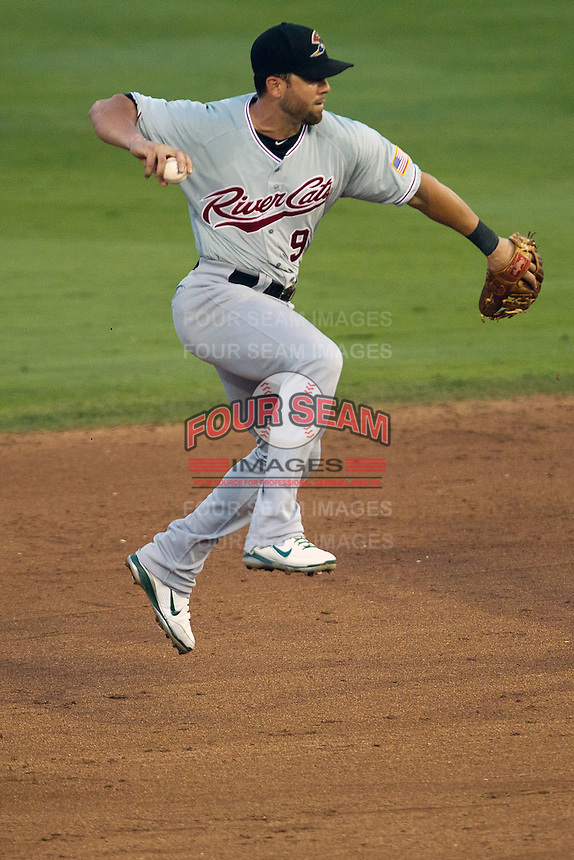 Sacramento River Cats shortstop Brandon Hicks #9 leaps to throw during the Pacific Coast League baseball game against the Round Rock Express on May 22, 2012 at The Dell Diamond in Round Rock, Texas. The Express defeated the River Cats 11-5. (Andrew Woolley/Four Seam Images)