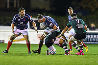 Neale Patrick of London Scottish tries to evade a tackle from TJ Harris of Nottingham Rugby during the Greene King IPA Championship match between London Scottish Football Club and Nottingham Rugby at Richmond Athletic Ground, Richmond, United Kingdom on 16 October 2015. Photo by David Horn.
