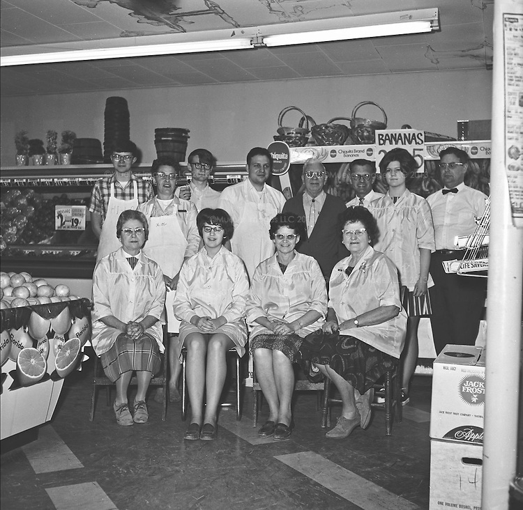"""Hi Lo Employees. March 1969<br /> -L to R Back row: Larry Hinzman, Jim Mueller, Steve Boyer, Don Mueller, J. Hopper<br /> -L to R Middle row: Ferne (Mrs. James, """"Duke"""") Halls, John E Mueller, Peggy  Pfailer<br /> -L to R Front row seated: Lena Wergin, Ruth McDill, Florence Mueller Huxford, Pearl Worden"""