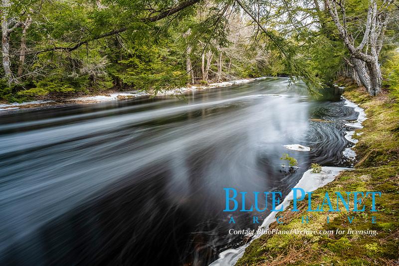 Mersey River flowing through Kejimkujik National Park in winter, Nova Scotia Canada