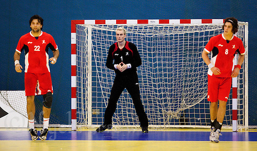 11 JUN 2010 - LONDON, GBR - Great Britain goalkeeper Jesper Parker flanked by team mates Robin Garnham (#22) and Martin Hare (#8) (both in red) prepare to defend against and Estonian attack during their 2012 European Handball Championships Qualification Tournament match (PHOTO (C) NIGEL FARROW)