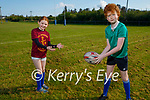 Luke and Eve O'Sullivan warming up as they get ready to return to training at the Tralee Rugby club on Saturday morning.