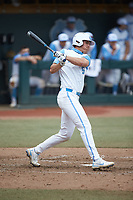 Tyler Causey (6) of the North Carolina Tar Heels follows through on his swing against the North Carolina State Wolfpack at Boshamer Stadium on March 27, 2021 in Chapel Hill, North Carolina. (Brian Westerholt/Four Seam Images)