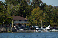 Foothill Aviation's Cessna 182N on floats, N8516M, docked at the Skylark Shores resort during the Clear Lake Seaplane Splash-In, Lakeport, Lake County, California