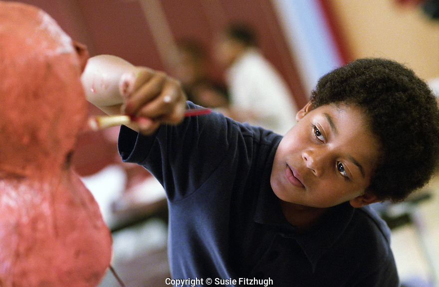 Madrona K-8 students work on sculptured heads under the guidance of Maikoiyo Alley-Barnes, an Arts Corps instructor & a printer, painter and sculptor.