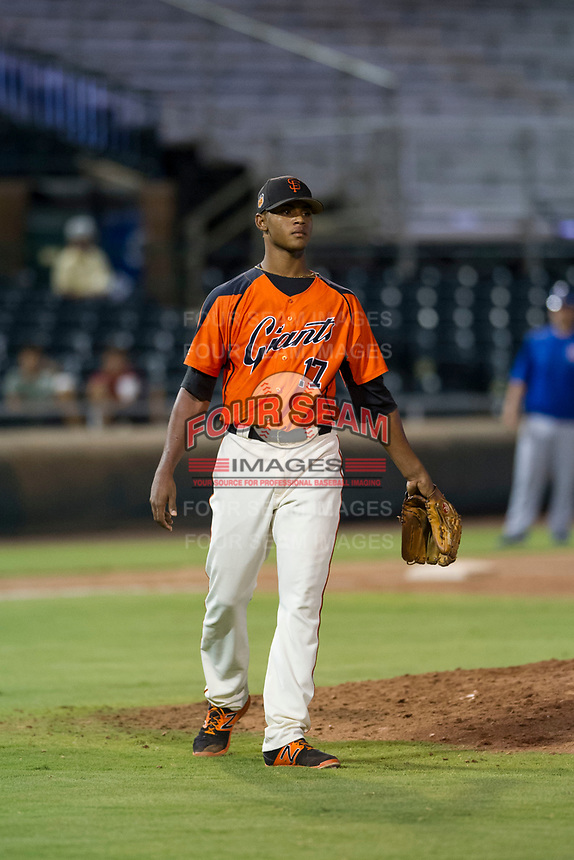 AZL Giants relief pitcher Camilo Doval (17) circles the mound after a strikeout against the AZL Cubs on September 5, 2017 at Scottsdale Stadium in Scottsdale, Arizona. AZL Cubs defeated the AZL Giants 10-4 to take a 1-0 lead in the Arizona League Championship Series. (Zachary Lucy/Four Seam Images)