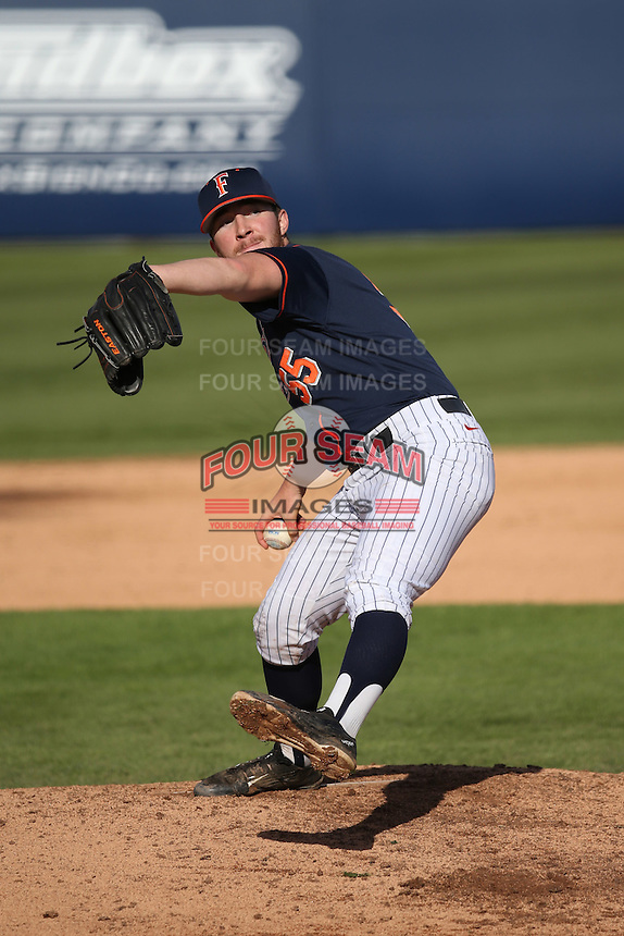 Blake Workman #55 of the Cal State Fullerton Titans pitches against the Stanford Cardinal at Goodwin Field on February 19, 2017 in Fullerton, California. Stanford defeated Cal State Fullerton, 8-7. (Larry Goren/Four Seam Images)
