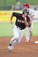 Ryan Leonards (12) of the Kannapolis Intimidators hustles towards third base against the Lakewood BlueClaws at CMC-NorthEast Stadium on July 20, 2014 in Kannapolis, North Carolina.  The Intimidators defeated the BlueClaws 7-6. (Brian Westerholt/Four Seam Images)