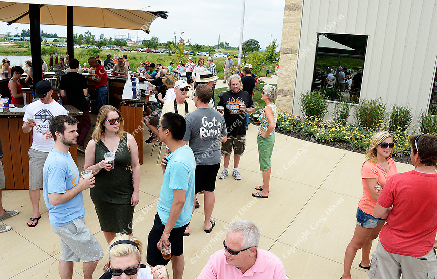 People enjoy beer during the Depth Charge brew party at Wisconsin Brewing Company on Sunday, July 12, 2015, in Verona, Wisconsin.
