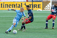 FOXBOROUGH, MA - SEPTEMBER 19: Alexandru Mitrita #28 of New York City FC turns to pass to the midfield with Brandon Bye #15 of New England Revolution in pursuit during a game between New York City FC and New England Revolution at Gillette on September 19, 2020 in Foxborough, Massachusetts.