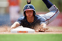 Atlanta Braves Jose Bermudez (15) slides head first into third base during an Instructional League game against the Baltimore Orioles on September 25, 2017 at Ed Smith Stadium in Sarasota, Florida.  (Mike Janes/Four Seam Images)