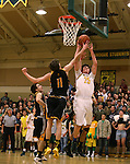 Manogue's Justin DeGeus shoots past Galena defender Josiah Wood at Manogue High School in Reno, Nev., on Tuesday, Feb. 11, 2014. Manogue won 66-59.<br /> Photo by Cathleen Allison