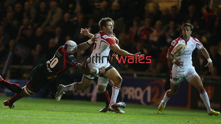 Ulster full back Jared Payne spills the ball as Dragons number 8 makes the tackle.<br /> RaboDirect Pro 12<br /> Newport Gwent Dragons v Ulster<br /> Rodney Parade<br /> 06.09.13<br /> <br /> ©Steve Pope-SPORTINGWALES