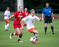 Morgan Brian (6) of Virginia carries the ball past Ashley Spivey (8) of Maryland during the game at Klockner Stadium in Charlottesville, VA.  Virginia defeated Maryland, 1-0.