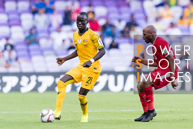 Awer Mabil of Australia (L) is tackled by Khalil Baniateyah of Jordan during the AFC Asian Cup UAE 2019 Group B match between Australia (AUS) and Jordan (JOR) at Hazza Bin Zayed Stadium on 06 January 2019 in Al Ain, United Arab Emirates. Photo by Marcio Rodrigo Machado / Power Sport Images