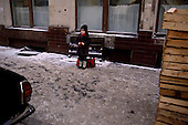 """Moscow, Russia<br /> Soviet Union<br /> December 10, 1991<br /> <br /> A young child, all dressed up for winter's cold, waits on the street.<br /> <br /> In December 1991, food shortages in central Russia had prompted food rationing in the Moscow area for the first time since World War II. Amid steady collapse, Soviet President Gorbachev and his government continued to oppose rapid market reforms like Yavlinsky's """"500 Days"""" program. To break Gorbachev's opposition, Yeltsin decided to disband the USSR in accordance with the Treaty of the Union of 1922 and thereby remove Gorbachev and the Soviet government from power. The step was also enthusiastically supported by the governments of Ukraine and Belarus, which were parties of the Treaty of 1922 along with Russia.<br /> <br /> On December 21, 1991, representatives of all member republics except Georgia signed the Alma-Ata Protocol, in which they confirmed the dissolution of the Union. That same day, all former-Soviet republics agreed to join the CIS, with the exception of the three Baltic States."""