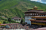 """Thimpu Dzong or Tashichoe Dzong during annual Tsechu festival. The Tshechu is a festival honouring Guru Padmasambhava, """"one who was born from a lotus flower."""" This Indian saint contributed enormously to the diffusion of Tantric Buddhism in the Himalayan regions of Tibet, Nepal, Bhutan etc. around 800 AD. He is the founder of the Nyingmapa, the """"old school"""" of Lamaism which still has numerous followers. The biography of Guru is highlighted by 12 episodes of the model of the Buddha Shakyamuni's life. Each episode is commemorated around the year on the 10th day of the month by """"the Tschechu"""". The dates and the duration of the festivals vary from one district to another but they always take place on or around the 10th day of the month according to the Bhutanese calendar. During Tshechus, the dances are performed by monks as well as by laymen. The Tshechu is a religious festival and by attending it, it is believed one gains merits. It is also a yearly social gathering where the people, dressed in all their finery, come together to rejoice. Arindam Mukherjee."""