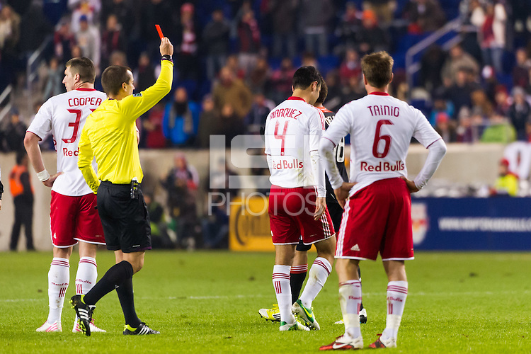 Referee Mark Geiger red cards Rafa Marquez (4) of the New York Red Bulls. D. C. United defeated the New York Red Bulls 1-0 (2-1 in aggregate) during the second leg of the MLS Eastern Conference Semifinals at Red Bull Arena in Harrison, NJ, on November 8, 2012.