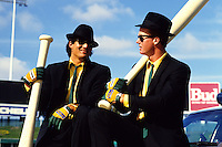 OAKLAND, CA - Jose Canseco and Mark McGwire of the Oakland Athletics pose for a Bash Brothers poster made by Costacos Brothers during a photo shoot after a game at the Oakland Coliseum in Oakland, California on June 16, 1988. (Photo by Brad Mangin)