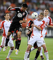 D.C. United midfielder Marcelo Saragosa (11) heads the ball against Toronto FC forward Nick Soolsma (18)  D.C. United defeated Toronto FC 3-1 at RFK Stadium, Saturday May 19, 2012.